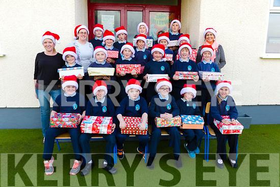 Pupils and staff at Scoil an Ghleanna, The Glen with their Team Hope Christmas Shoe Boxes all ready for collection, pictured front l-r; Ellen Ní Laoire, Jack Ó Céilleachair, Jack de Barra, Sean Ó Súilleabháin, Peadar Ó Gabháin, Katie Ní Chéilleachair, middle l-r; Sorcha Ní Chatháin, Tadhg Ó Gabháin, Aodhán Ó Mongáin, Dáithí Ó Sé, Meabh Ní Shuilleabháin, Tadhg Ó Laoire, Hannah Ní Mhurchú, back l-r; Elaine Ní Churráin, William Ó Mongáin, Orla de Bharóid, Sean Ó Dálaigh, Finn de Baróid, Ronan Ó Dubhda, Dylan Ó Conaill, Dara Ó Murchú, Cathal Ó Cathasaigh agus Louise Ní Shé.