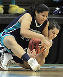 Bishop McGuinness' Erin Liebal, right, fights for a loose ball with Southside High School's Kyajia Mourning during the Villains' 60-44 win, a 7th-consecutive state title and a new state record, at the Dean Smith Center in Chapel Hill, NC, on Saturday, March 10, 2012.  Photo by Ted Richardson