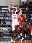 Texas - Arlington Mavericks forward Briana Walker (21) blocks out Nicholls State University Colonels forward Cassie Hearon (31) in the game between the UTA Mavericks and the  Nicholls State University Colonels  held at the University of Texas in Arlington's Texas Hall in Arlington, Texas. UTA defeats Nicholls 69 to 62