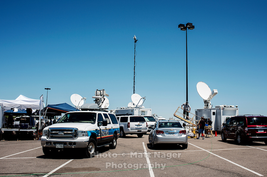 The media set up next to the Aurora Century 16 movie theater where James Holmes (cq), 24, is in custody and is suspected of killing 12 people and wounding many more in Aurora, Colorado, Saturday, July 21, 2012. The shootings occurred during the midnight premiere of the new Dark Knight Batman movie...Photo by MATT NAGER