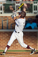 Texas A&M Aggie outfielder Tyler Naquin #18 follows through on his swing during the NCAA Tournament Regional baseball game against the Dayton Flyers on June 1, 2012 at Blue Bell Park in College Station, Texas. The Aggies defeated the Flyers 4-1. (Andrew Woolley/Four Seam Images).