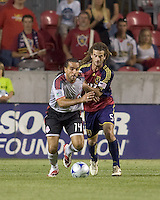 Toronto FC midfielder Dwayne De Rosario (14) attempts to pull away from Real Salt Lake midfielder Kyle Beckerman (5). Salt Lake Real defeated Toronto FC, 3-0, at Rio Tinto Stadium on June 27, 2009.