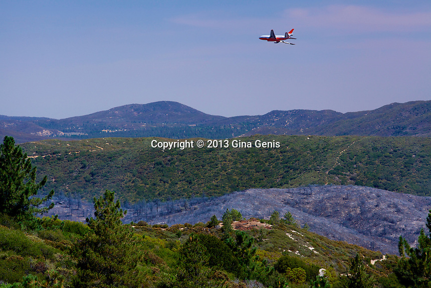 DC 10 descends over a burn area of Mountain Center to drop fire retardant on July 16, 2013.