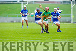 Lixnaw's Jeremy McKenna in possession under the watchful eyes of St Brendans Darren Dinneen and David Griffin in the Qtr final of the Senior Hurling Championship in Austin Stack Park on Sunday.