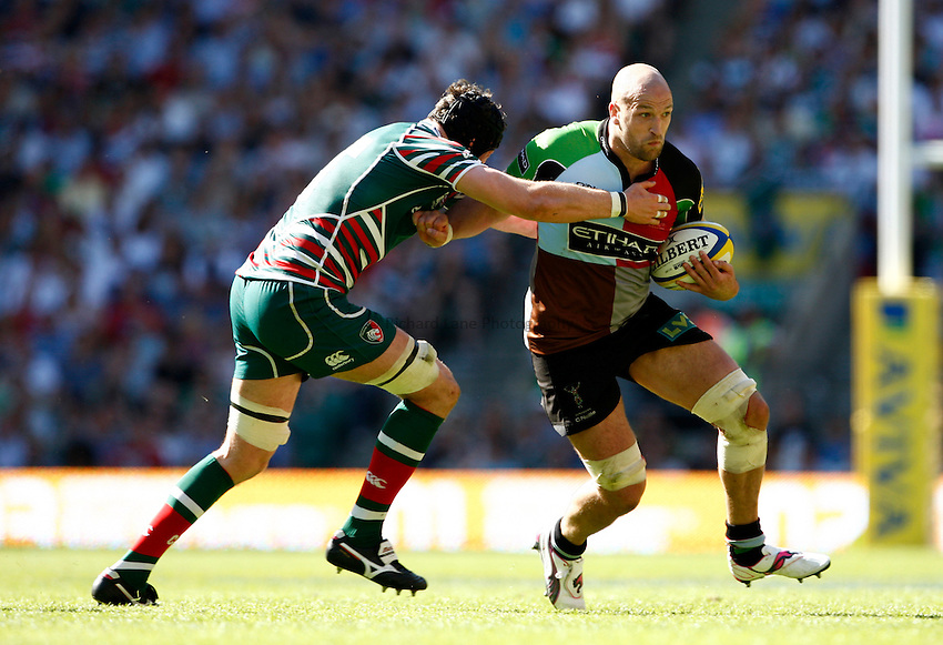 Photo: Richard Lane/Richard Lane Photography. Harlequins v Leicester Tigers. Aviva Premiership Final. 26/05/2012. Quins' George Robson is tackled by Tigers' George Skivington.
