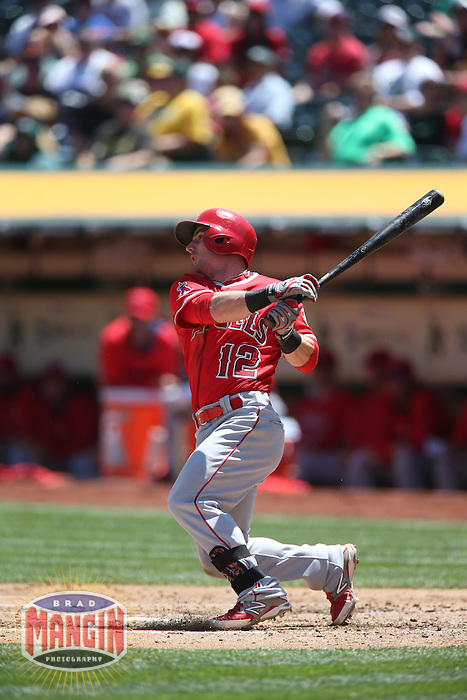 OAKLAND, CA - APRIL 30:  Johnny Giavotella #12 of the Los Angeles Angels bats against the Oakland Athletics during the game at O.co Coliseum on Thursday, April 30, 2015 in Oakland, California. Photo by Brad Mangin
