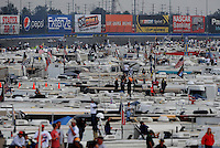 Oct. 11, 2009; Fontana, CA, USA; NASCAR Sprint Cup Series fans watch from the infield during the Pepsi 500 at Auto Club Speedway. Mandatory Credit: Mark J. Rebilas-