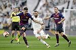 Real Madrid CF's  Karim Benzema and FC Barcelona's Sergio Busquets, Arthur Melo during La Liga match. March 02,2019. (ALTERPHOTOS/Alconada)