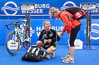 17 JUL 2011 - HAMBURG, GER - Rachel Klamer (NED) (left) talks with Dutch team mate Lisa Mensink (NED) in transition before the start of the women's Hamburg round of triathlon's ITU World Championship Series (PHOTO (C) NIGEL FARROW)