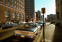 Church Street New Haven CT looking South in the Block between Elm Street and Wall Street next to the County Court House in 1975. Union Trust Company Building on Left, New Haven Savings Bank further up on the same side, The New Haven Green in the distance. Foreground Ford, maybe a Fairlaine, Auto Parked at Meter.