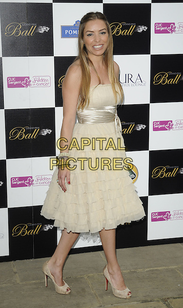 ELEN RIVAS .Attending The Grand Prix Ball at The Hurlingham Club, London, England, .UK, 7th July 2010. .full length strapless cream beige ruffles tiered ruffle bow peep toe shoes yellow  bracelets christian louboutin .CAP/CAN.©Can Nguyen/Capital Pictures.