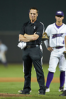 Winston-Salem Dash trainer Josh Fallin watches pitcher Ian Clarkin (not pictured) throw a pitch after having been hit in the ankle by a line-drive during the game against the Frederick Keys at BB&T Ballpark on July 26, 2018 in Winston-Salem, North Carolina. The Keys defeated the Dash 6-1. (Brian Westerholt/Four Seam Images)