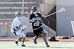La Canada Flintridge, CA 03/16/13 - Brett Inglesby (De La Salle #13) and Kevin Fahey (Coronado #28) in action during the De La Salle vs Coronado lacrosse game at St Francis High School.  De La Salle defeated Coronado 8-5.