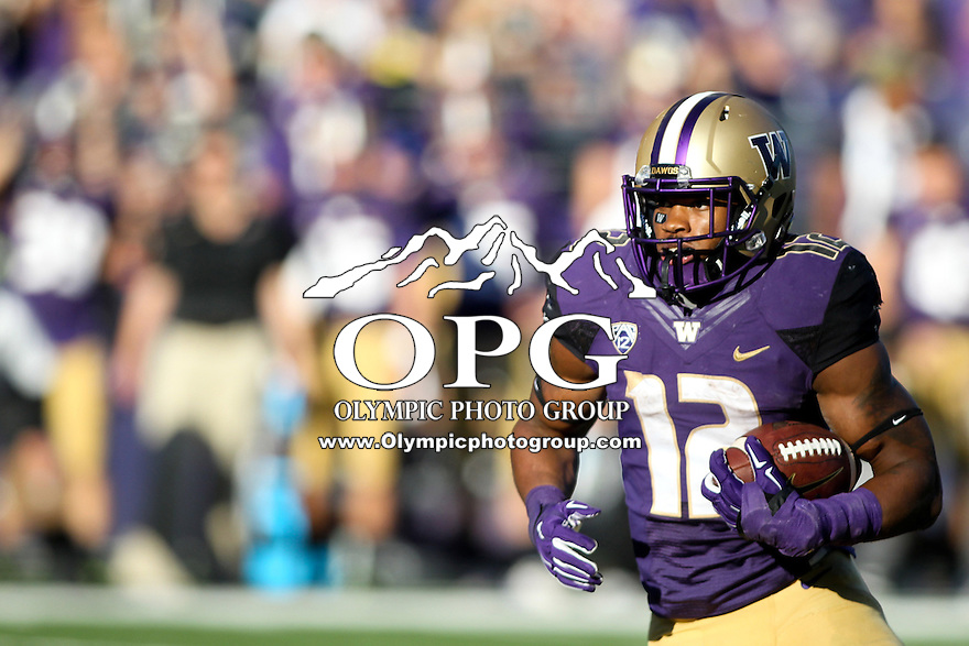 Sept 20, 2014:  Washington's #12 Dwayne Washington breaks up field for a first down against Georgia State.  Washington defeated Georgia State 45-14 at Husky Stadium in Seattle, WA.