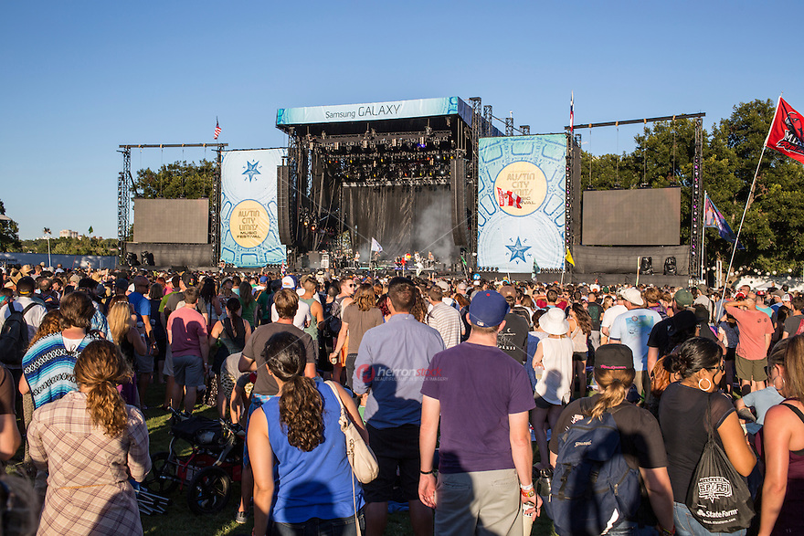 Austin, Texas - October 12: Thousands of concert goers stand in front of a concert stage to listen to their favorite bands during the Austin City Limits Music Festival, October 12, 2014.<br /> <br /> Release Information: Editorial Use Only.<br /> Use of this image in advertising or for promotional purposes is prohibited.