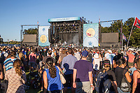 Austin, Texas - October 12: Thousands of concert goers stand in front of a concert stage to listen to their favorite bands during the Austin City Limits Music Festival, October 12, 2014.<br />