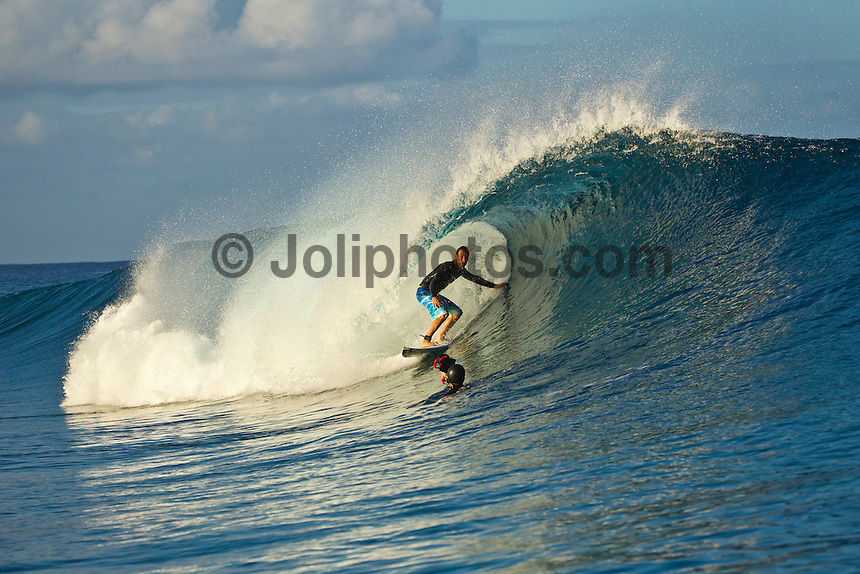 Teahupoo, Tahiti Iti, French Polynesia. Sunday August 21 2011. Joel Parkinson (AUS) riding switchfoot at Teahupoo. A mix of south west and west swell in the 4' range was hitting the main reef at Teahupoo today. Photo: joliphotos.com