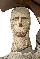 Close up of head of 9th century BC Giants of Mont'e Prama  Nuragic stone statue of a boxer, Mont'e Prama archaeological site, Cabras. 2014 excavation. Civico Museo Archeologico Giovanni Marongiu - Cabras, Sardinia. White background