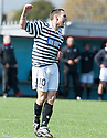Queens Park's Shaun Frazer celebrates after he scored the equaliser.