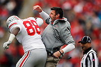 Ohio State defensive line coach Mike Vrabel congratulates defensive lineman Steve Miller (88) after making a tackle for a loss during the fourth quarter of the NCAA football game against Purdue at Ross-Ade Stadium in West Lafayette, Ind. on Nov. 2, 2013. (Adam Cairns / The Columbus Dispatch)