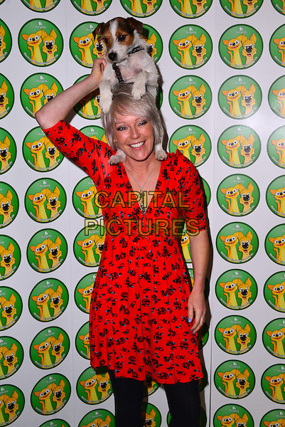 Helen Chamberlain and Spud.Attends the Burgess Wetnose Awards 2013 at Jumeriah Carlton Tower hotel, London, England..March 11th, 2013.half length black red floral print dress carrying holding dog animal pet on head funny over shoulders.CAP/BF.©Bob Fidgeon/Capital Pictures.