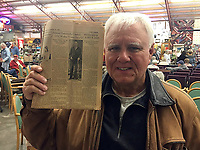 COURTESY PHOTO/Jackie Chesnutt, moments after discovering a fated find in his estate sale purchases. The newspaper, from 1933, recounts Chesnutt's father's miraculous recovery after being crushed by a dump truck.