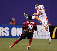 The Chicago Fire's Chris Armas goes high for the ball as the MetroStars' Fabian Taylor watches. The Chicago Fire played the NY/NJ MetroStars to a one all tie at Giant's Stadium, East Rutherford, NJ, on May 15, 2004.