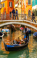 Gondolas ply a route along a back canal, Venice, Italy.