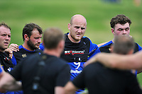 Matt Garvey of Bath Rugby looks on in a huddle. Bath Rugby training session on August 4, 2015 at Farleigh House in Bath, England. Photo by: Patrick Khachfe / Onside Images