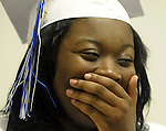 Ebony Campbell of Bloomfield, gets chocked up with the emotion of the of her pending graduation taking to Brandon Velez of East Hartford, prior to the Great Path Academy graduation ceremony, Wednesday, June 12, 2013, at Manchester Community College. (Jim Michaud / Journal Inquirer)