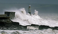 "WEATHER PICTURE WALES<br /> Pictured: Waves crashing against the harbour wall and lighthouse in Porthcawl, Wales, UK. Monday 11 September 2017<br /> Re: A yellow ""be aware"" weather warning of very strong winds has been issued across south and west Wales The Met Office HAS warned.<br /> Gusts could reach 50 mph inland and 60 mph along the coast."
