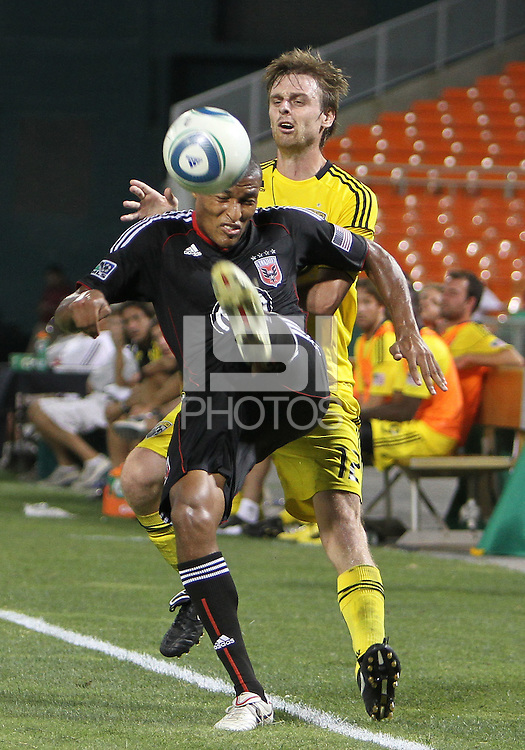 Jordan Graye #16 of D.C. United boots the ball over Eddie Gaven #12 of the Columbus Crew during a US Open Cup semi final match at RFK Stadium on September 1 2010, in Washington DC. Columbus won 2-1 aet.