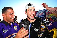 Oct. 16, 2011; Chandler, AZ, USA; NHRA pro stock driver Vincent Nobile celebrates with his crew after winning the Arizona Nationals at Firebird International Raceway. Mandatory Credit: Mark J. Rebilas-