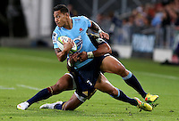 Waratahs Israel Folau in the tackle of Highlanders Malakai Fekitoa in the Super 15 rugby match, Forsyth Barr Stadium, Dunedin, New Zealand, Saturday, March 14, 2015. Credit: SNPA/Dianne Manson