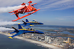 Aerobatic air show legend Sean D. Tucker flies his Oracle Challenger IV inverted and in formation with two Navy Blue Angel's F/A-18 Hornets over the Atlantic City, NJ boardwalk Tuesday, Aug. 22, 2006. The Blue Angel's, and the Air Force Thunderbirds jet team will be the featured teams during the Wednesday, Aug. 22, 2006 air show.(Photo/Victoria Arocho)