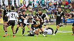 Matt Proctor is tackled. Maori All Blacks vs. Fiji. Suva. July 11, 2015. Photo: Marc Weakley