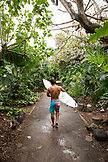 USA, Oahu, Hawaii, MMA Mixed Martial Arts Ultimate fighter Lowen Tynanes walks with his surfboard on his way to surf Pipeline Beach, North Shore of Oahu