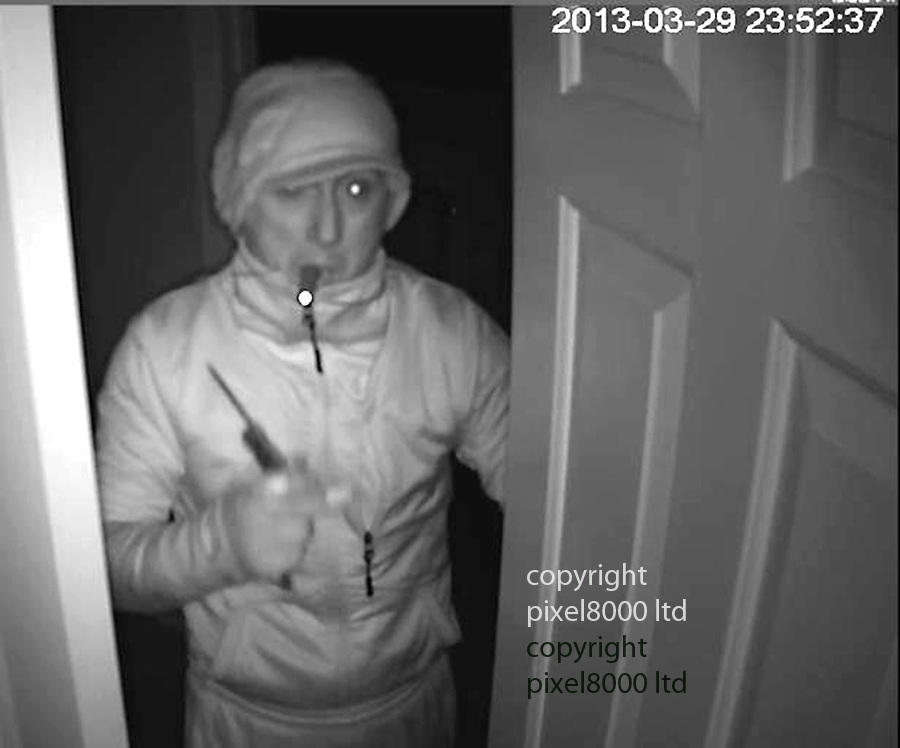 Pic shows:  CCTV of burglary caught red handed on CCTV as he burgles homes of rich and famous in Wimbledon - including tennis legend Boris Becker<br /> <br /> He's been captured on camera breaking into several multi-million pound homes in south London. He targets the rich and famous and detectives believe he's responsible for over one hundred and forty offences, including at the family home of tennis legend Boris Becker.<br /> <br /> For the past 7 years he's targeted many properties in the Wimbledon area. He spends several days plotting a route into a house, and cuts CCTV cables around the properties so he is not seen. He doesn't take that much the first time he enters, and often the owners of properties are unaware that they have been burgled. The suspect often uses ladders to scale fences and break in through upstairs windows.<br /> CCTV images show him as far back as 2008, in some of the footage he has his hand to his mouth. Officers think he was recording notes on a dictaphone that he can then use the next time he breaks in. On the 29th March last year he burgled a home in Bathgate Road, Wimbledon, he got away with a quantity of cash and jewellery. He was caught on CCTV when he opened a door, he was clearly not expecting to see the camera.<br /> In another clip he's seen casually walking around a kitchen where he takes his time inspecting drawers. The intruder wears a tracksuit, gloves and a hat.<br /> In October this year the burglar was caught on CCTV attempting to get into the home of Boris Becker on Wimbledon Common. This was about 00:50hrs. The alarm goes off, and he escapes. But officers know he's tried to gain entry to the house on another occasion afterwards.<br /> <br /> <br /> <br /> <br /> Picture by  Pixel8000 07917221968