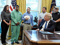 United States President Donald J. Trump listens as one of the observers, far left, makes a statement prior to signing the National Manufacturing Day Proclamation in the Oval Office of the White House in Washington, DC on Friday, October 6, 2017.<br /> CAP/MPI/CNP/RS<br /> &copy;RS/CNP/MPI/Capital Pictures