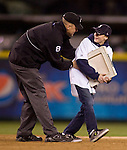 First Sergeant Steve Smeere, dressed in an umpires uniform surprises his 13-year-old son, Kyle Smerer at second base during the Steal-A-Base Contest held in the 5th inning of the Seattle Mariners vs. Oakland Athletics game at SAFECO Field in Seattle April 13, 2012. Smerer, a soldier stationed at the Joint Base Lewis McChord, was serving in Afghanistan, contacted the Mariners  and asked if they could help in setting up the surprise.   © 2012. Jim Bryant Photo. All Rights Reserved.