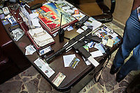 A machine gun sits on the desk of Basil Seif, at his office in the Jaramana neighbourhood of Damascus, Syria. Basil is an estate agent and contractor by trade but during the crisis he has become a member of the National Defence Army and is responsible for the checkpoint in his zone. The NDA is made of members of the local population who asked the government to arm them in order to protect their neighbourhoods.