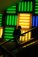 NEW YORK - APRIL 1: A customer rides the escalator at the Toys 'R' Us super-store in Times Square, April 1, 2004 in New York City. This flagship Toys 'R' Us super-store, a popular attraction for visiting tourists, is so big, that there is a ferris-wheel inside. Times Square's 100th birthday is April 8, 2004. On April 8, 1904, Mayor George McClellan signed a resolution changing the name of Long Acre Square to Times Square. Times Square, a living icon of popular culture, is one of the most familiar and most frequently reproduced fragments of urban real estate on the planet. (Photo by Landon Nordeman, 2004).