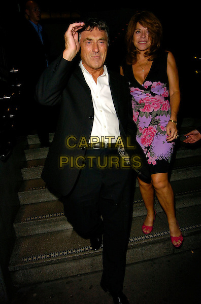 BILLY MURRAY & WIFE.Guys & Dolls - cast change press night, Picadilly Theatre, London, UK..August 7th, 2006.Ref: CAN.full length married husband wife Bill black suit purple floral print dress .www.capitalpictures.com.sales@capitalpictures.com.©Can Nguyen/Capital Pictures.