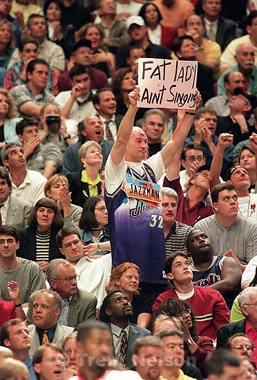 JazzMan Mike Douros holds &quot;Fat lady ain't singing&quot; sign at Jazz vs. Bulls, game 4 of the NBA Finals. Bulls won<br />