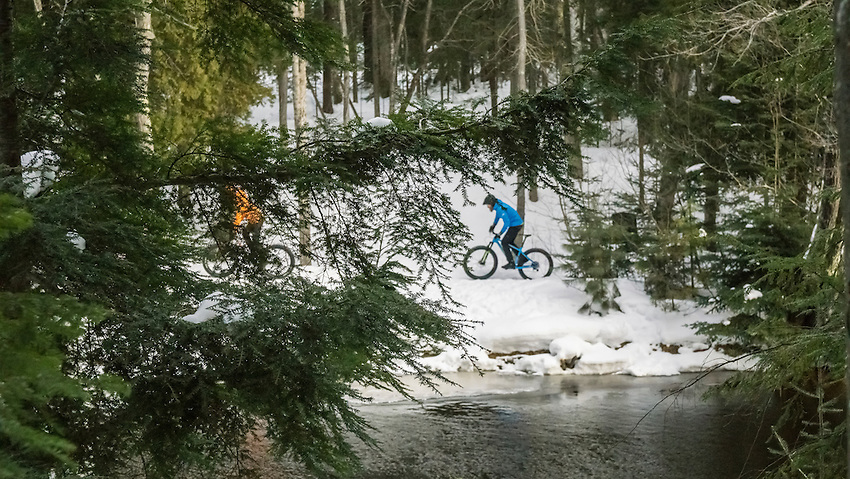 Winter cycling on fat bikes along the Dead River in Marquette, Michigan.