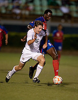 Billy Schuler (16) kicks the ball ahead of Derrick Johnson (5). Costa Rica defeated the US Under 20 Men's National team 3-0 during the 2009 CONCACAF U-20 Championship game at Marvin Lee Stadium Trinidad & Tobago in Macoya, Trinidad on March 17th, 2009.