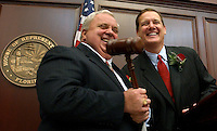 TALLAHASSEE 3/4/03-Senate President Jim King, R-Jacksonville, left, and House Speaker Johnnie Byrd, R-Plant City, joke as Byrd passes the gavel to King to start the joint session of the legislature Tuesday at the Capitol in Tallahassee. . COLIN HACKLEY PHOTO