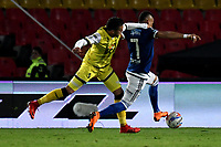 BOGOTA - COLOMBIA - 22 – 03 - 2018: Ayron del Valle (Der.) jugador de Millonarios disputa el balón con Carlos Perez (Izq.) jugador de Alianza Petrolera, durante partido aplazado de la fecha 8 entre Millonarios y por la Liga Aguila I 2018, jugado en el estadio Nemesio Camacho El Campin de la ciudad de Bogota. / Ayron del Valle (R) player of Millonarios vies for the ball with Carlos Perez (L) player of Alianza Petrolera, during a posponed match of the 8th date between Millonarios and Alianza Petrolera, for the Liga Aguila I 2018 played at the Nemesio Camacho El Campin Stadium in Bogota city, Photo: VizzorImage / Luis Ramirez / Staff.