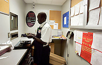 "John Madut (cq) counts a cash drawer at the start of his shift at the Toco Hills Publix on Friday, Sept. 1, 2006. One of the ""Lost Boys of Sudan,"" Madut has worked at the grocery store since 2003. This year he returned to Sudan for the first time since leaving and saw that his home town is in desperate need of clean drinking water. He's trying to help by raising funds for a new well, but has found the effort to be a financially monumental task."