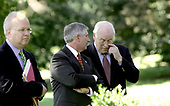 Washington, D.C. - September 5, 2005 -- Karl Rove, (holding papers on left), White House Chief of Staff Andrew Card and Vice President Dick Cheney watch United States President George W. Bush deliver his weekly radio address. The event was held in the Rose Garden of the White House on September 3, 2005.  <br /> Credit: Dennis Brack - Pool via CNP